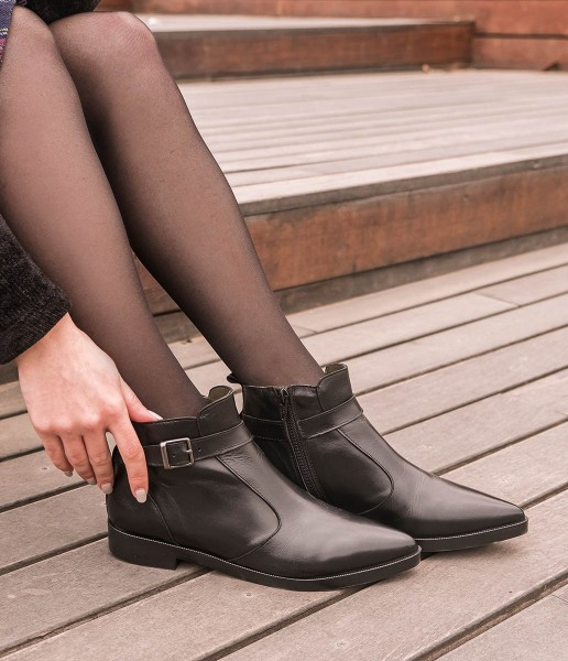 Flat leather ankle boots with ankle strap and buckle