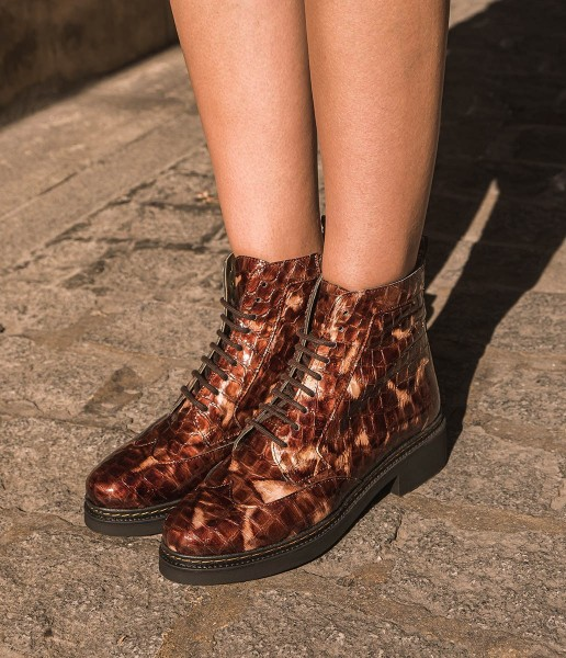 Engraved patent leather combat boot and track sole