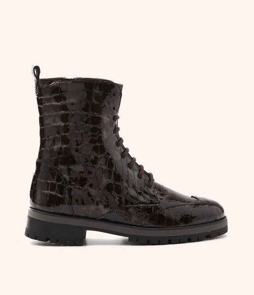 Combat boots with textured patent leather laces