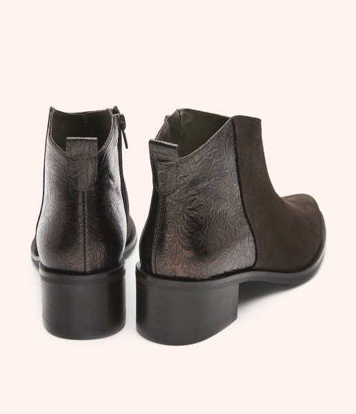 Leather ankle boots combined with smooth suede and metallic engraving with heel.