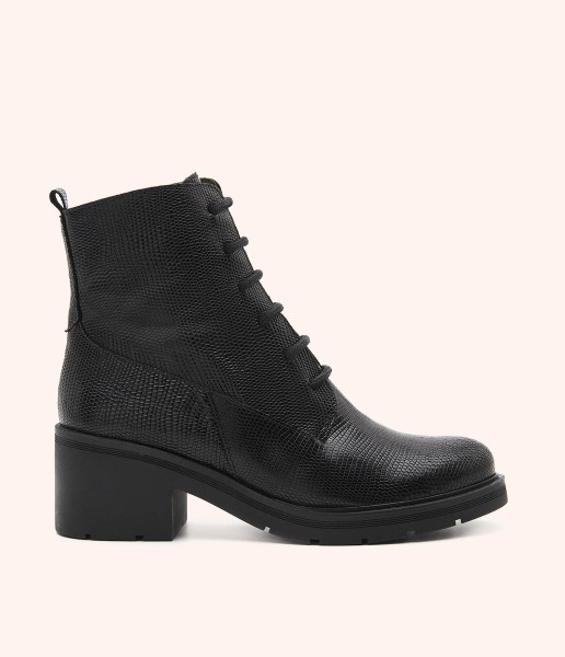 Combat boot in leather with micro texture and track sole with heel.