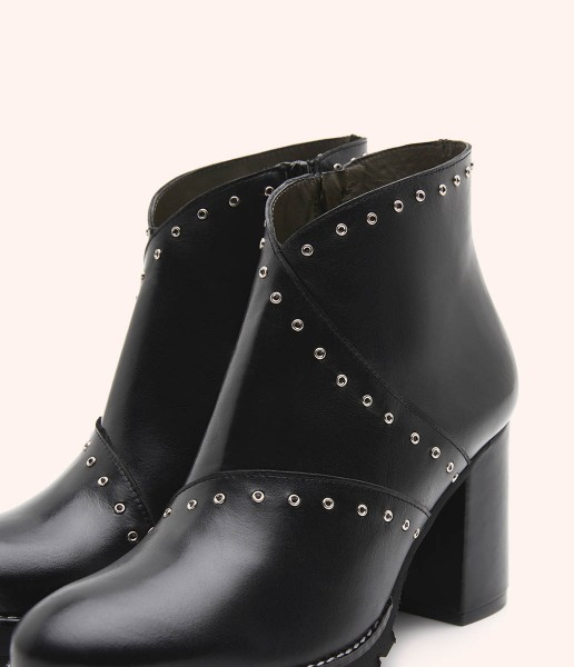 High-top leather ankle boot with studs and heel detail.