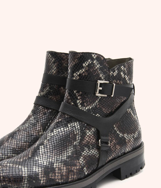 Biker ankle boots with Safari style print and engraving, with leather straps and buckle.